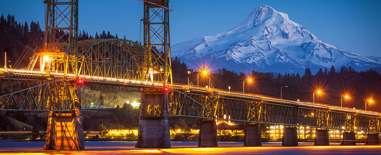 The Hood River Inn and Mount Hood through the iconic Hood River Bridge